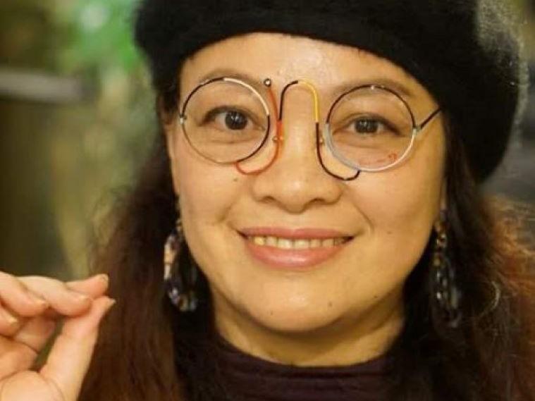 誠眼鏡店で購入したカサノバ(イタリアンヴィンテージメガネ)をかけているえみさんの顔写真